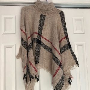 Poncho NEVER worn..